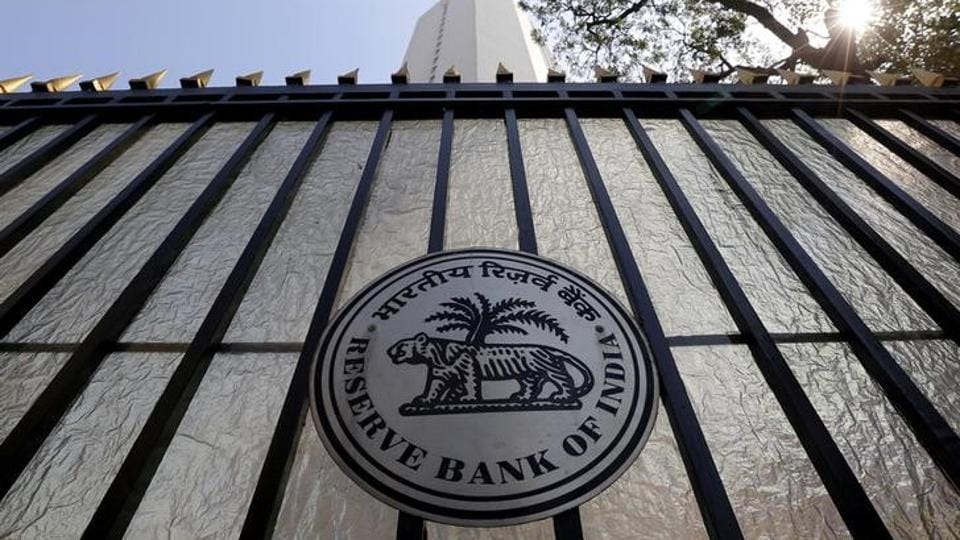 FILE PHOTO: The Reserve Bank of India (RBI) seal is pictured on a gate outside the RBI headquarters.