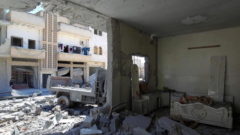A general view shows damage at a site hit by airstrikes on Tuesday in the town of Khan Sheikhoun in rebel-held Idlib, Syria.