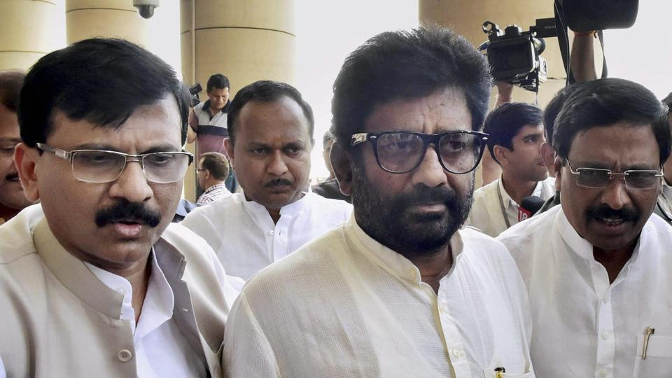 Ravindra Gaikwad (C) with Shiv Sena spokesperson Sanjay Raut (L) and party MPs after a press conference at Parliament on Thursday.