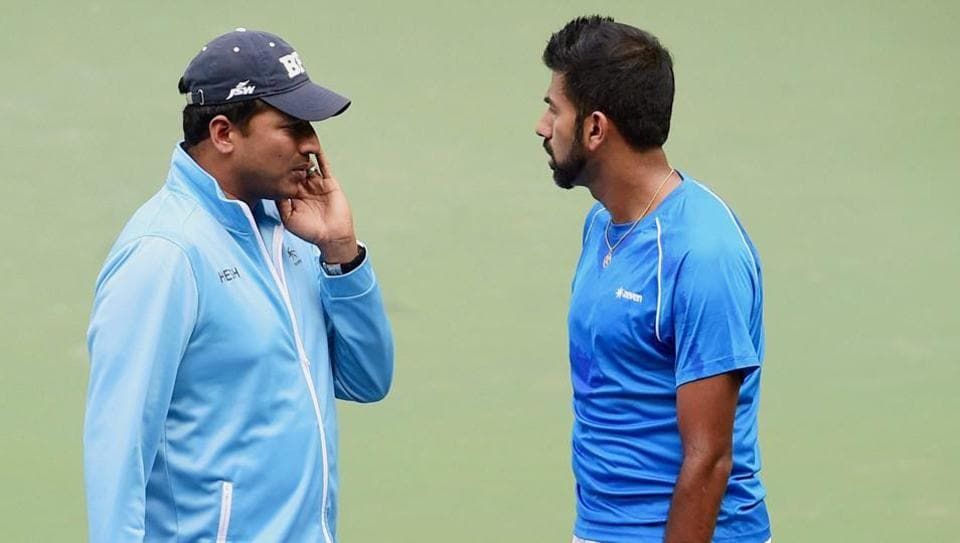 Rohan Bopanna with India's non-playing captain Mahesh Bhupathi during a practice session ahead of the Davis Cup tennis tie against Uzbekistan in Bangalore this weekend.
