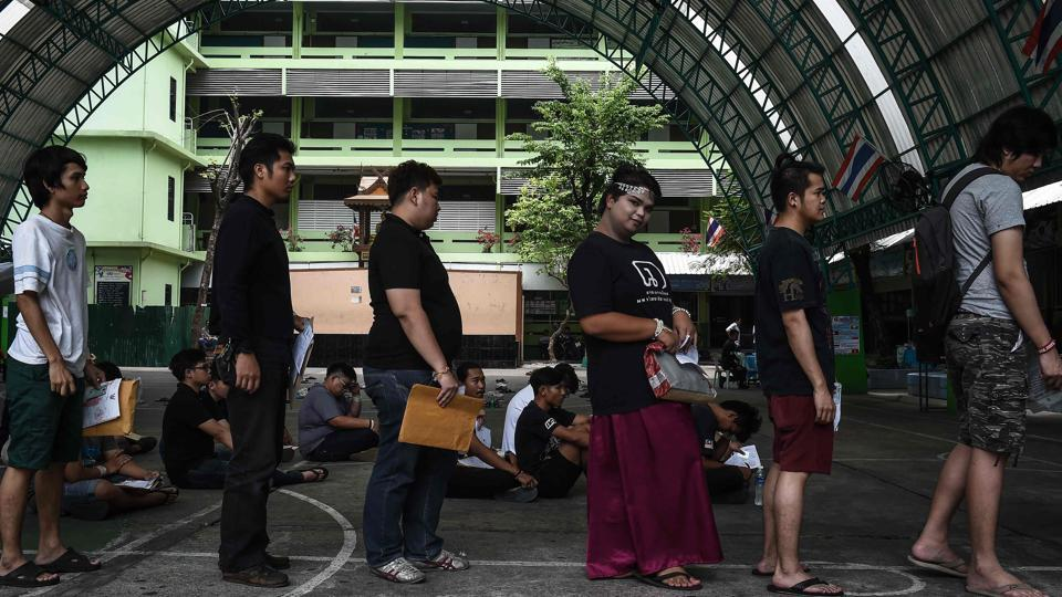 Potential draftees line up to register during the annual military draft in Bangkok on April 5.