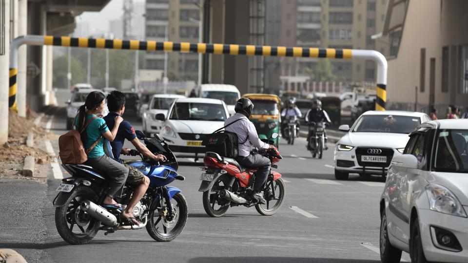 Vehicles take the U-turn near the underpass at DLF-1 Rapid Metro station in Gurgaon on Thursday.