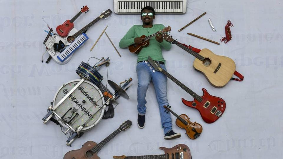 Mumbai is home to countless musicians, who traverse the city in search of venues to showcase their talent. Some are guitarists, and many play drums. Meet Peter Gladson,  24, who can play 13 instruments at the same time and has been identified as India's first and Mumbai's only 'one-man band'. (Kunal Patil/ht photo)