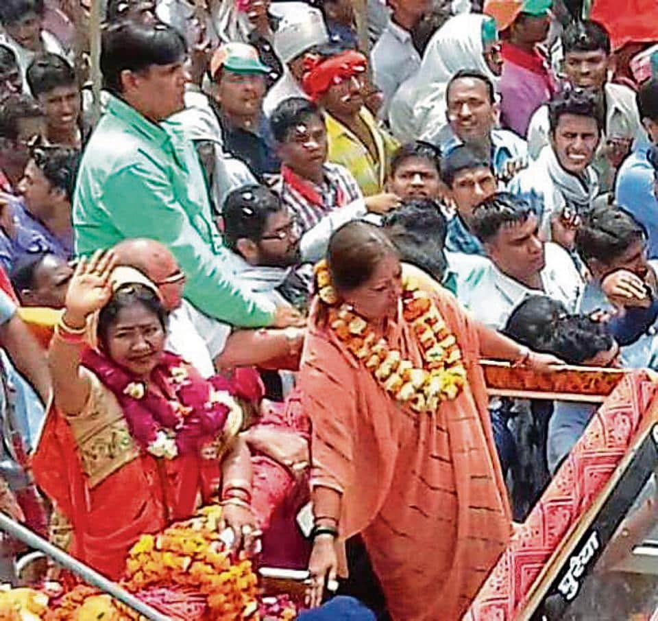 Chief minister Vasundhara Raje during a roadshow in Dholpur to seek votes for BJP candidate Shoba Rani Kushwaha.