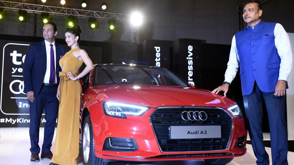Audi India head Rahil Ansari poses with former Indian cricketer Ravi Shastri and Bollywood actor Nimrat Kaur at the launch of Audi A3. The new executive sedan  starts at Rs 30.5 lakh in petrol variant and Rs 32.30 lakh (ex-showroom Delhi) for the diesel variant.  (Sonu Mehta/HT PHOTO)