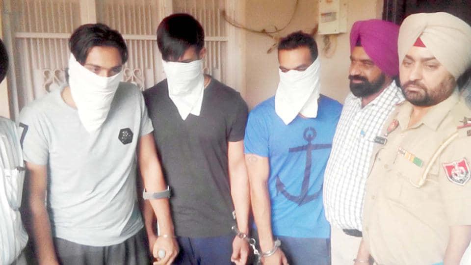 The drug-peddling accused in police custody in Batala on Friday, April 6.
