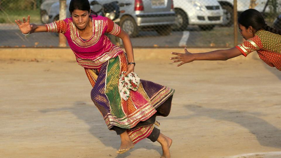 A recently concluded traditional sports tournament held in Jaipur brings the lens back on our rich and cultural sports heritage and a feeling of the actual rural milieu from which they originate. Seen above is the popular Rumal-Jhapatta (Grab the handkerchief) played by girls in Gaaghra-Odhni traditional attire.  (Himanshu Vyas/ht photo)