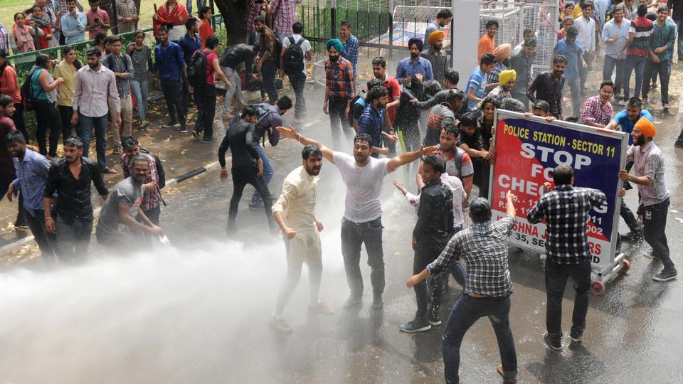 Police using cannons to disperse students from the V-C office complex at Panjab University on Thursday.