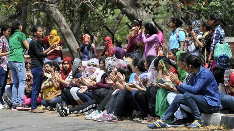 Students protesting outside PG Government College for Girls, Sector 11, in Chandigarh on Thursday.