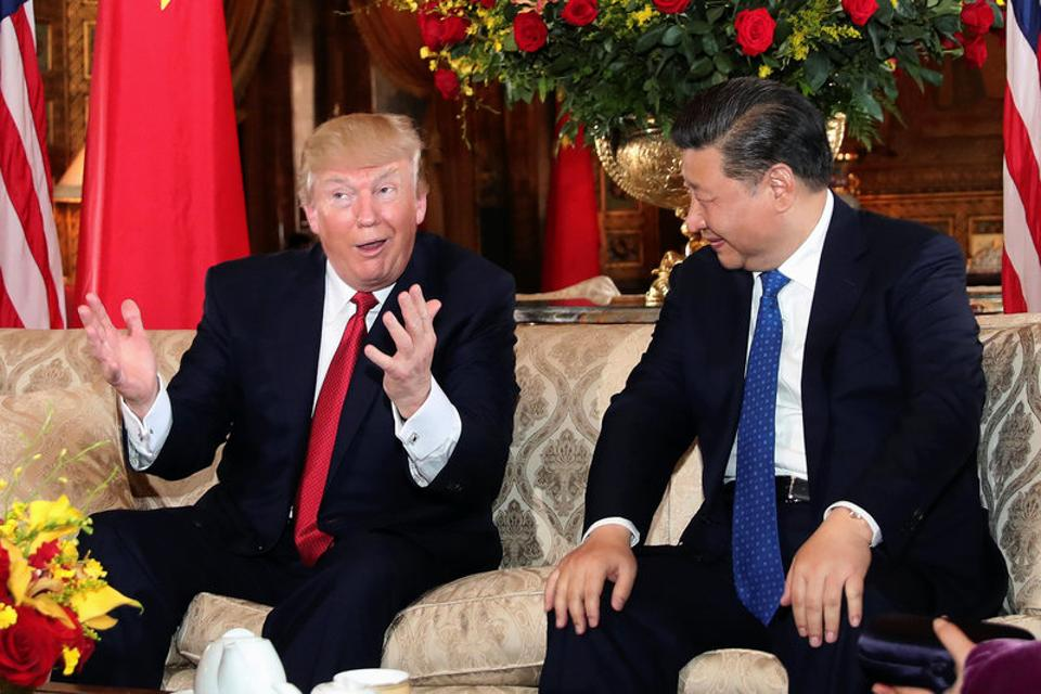 U.S. President Donald Trump interacts with Chinese President Xi Jinping. The summit at Trump's Spanish-style Mar-a-Lago resort in Palm Beach, Florida, got off to a cordial start.  (Carlos Barria/REUTERS)