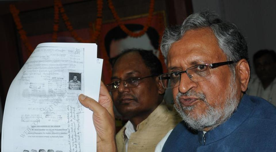 BJP leader Sushil Modi displaying documents in support of his charges, at a press meet in Patna on Friday.