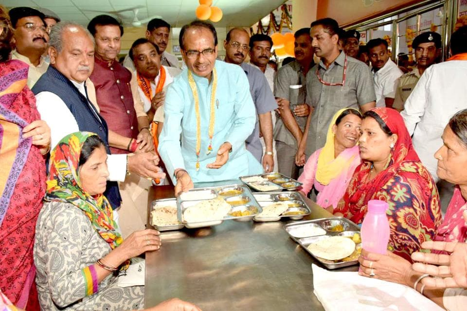 Bhopal, India - April 7, 2017: Madhya Pradesh chief minister Shivraj Singh Chouhan serving food during launch of Deendayal Rasoi yojna in Gwalior, India, on Friday, April 7, 2017.  Mujeeb Faruqui