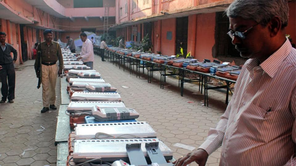 Electronic Voting Machines being checked by Election Commission officials.