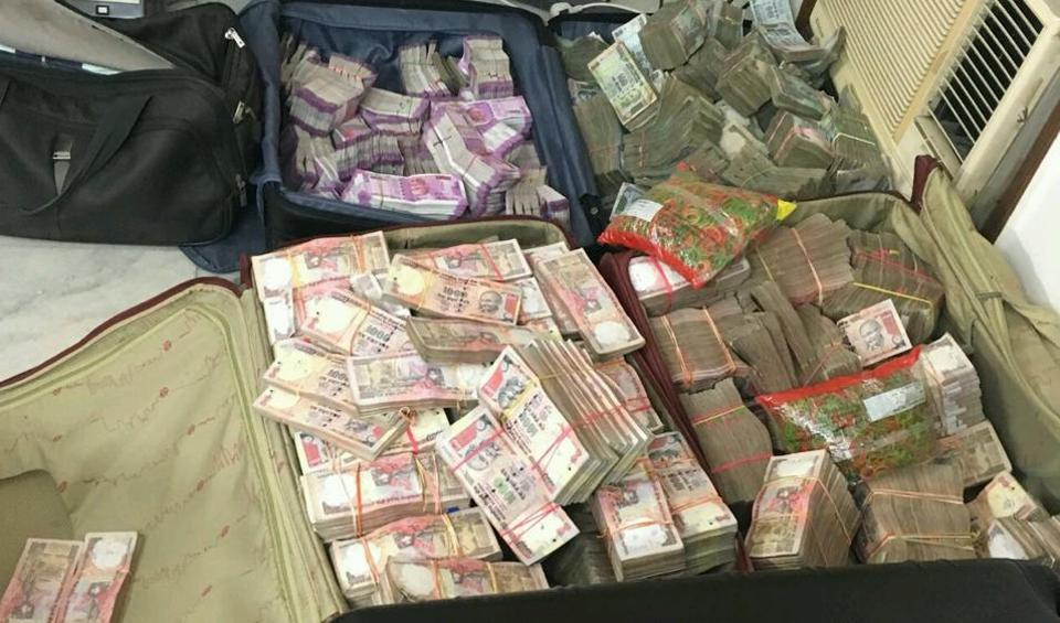 File photo of cash seizure at a law firm in south Delhi's Greater Kailash-I area. Rs. 13 crore was recovered in cash, of which Rs. 2.5 crore was in new currency notes.