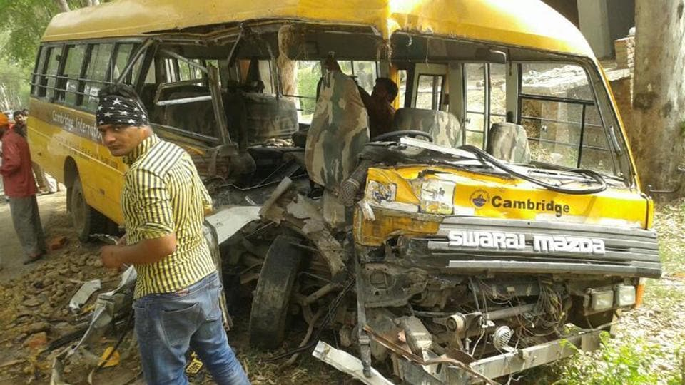 The mangled school bus after an accident near Hoshiarpur on Friday, April 7.