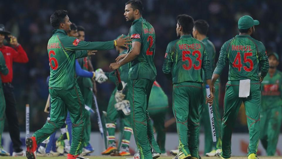 Bangladeshi team members congratulate their captain Mashrafe Mortaza as they celebrate their victory over Sri Lanka in the second T20 cricket in Colombo on Thursday.
