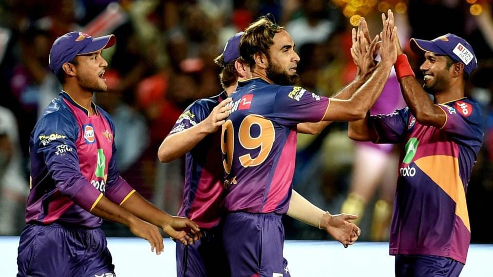 Rising Pune Supergiants bowler Imran Tahir celebrates the wicket of Mumbai Indians batsman Jos Buttler. (PTI)