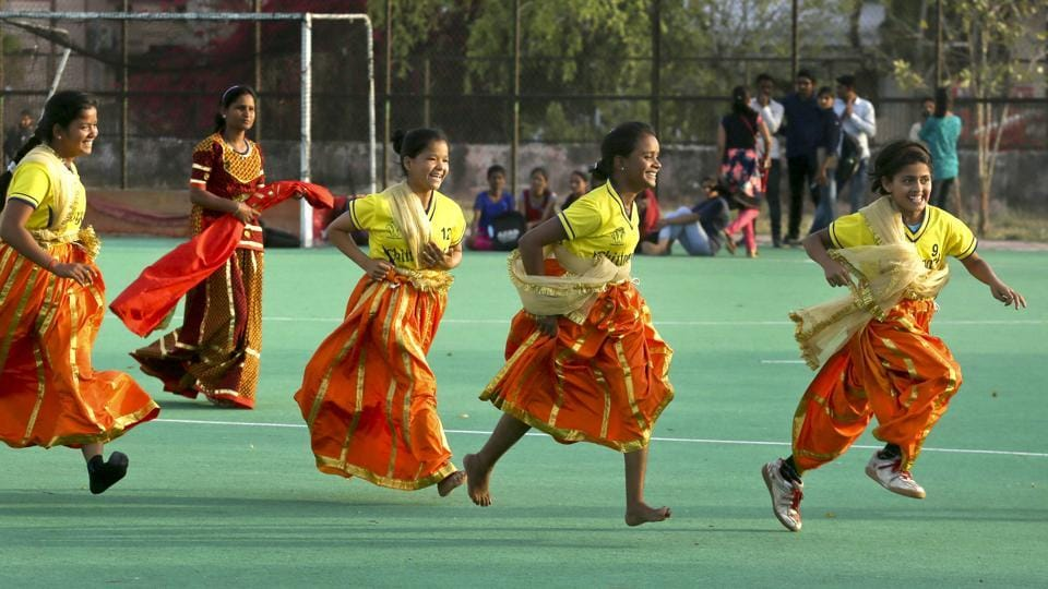 Girls wearing traditional dresses rejoice over a win in a Satoliya game. (Himanshu Vyas/ht photo)