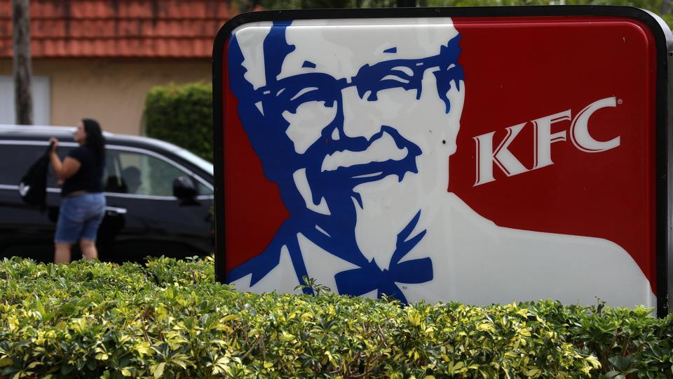A Kentucky Fried Chicken (KFC) logo pictured on a sign in North Miami Beach, Florida, US. The company is the latest corporation to stay away from chickens raised using antibiotics – an issue that has become a flashpoint among health activists