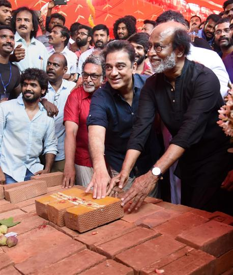 Tamil Super Stars Rajinikanth and Kamal Hassan during foundation stone laying ceremony of South Indian Film Artistes' Association building in Chennai on Friday.