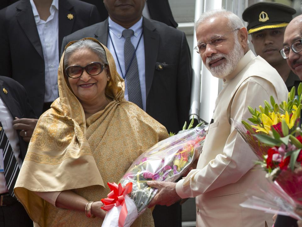 Prime Minister Narendra Modi greets Sheikh Hasina, his Bangladeshi counterpart, upon her arrival in New Delhi on Friday.