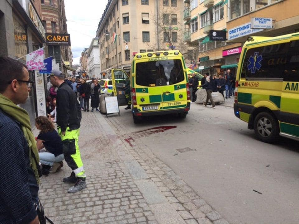 Ambulances on a street in central Stockholm where a truck was driven into a crowd, killing at least three people.