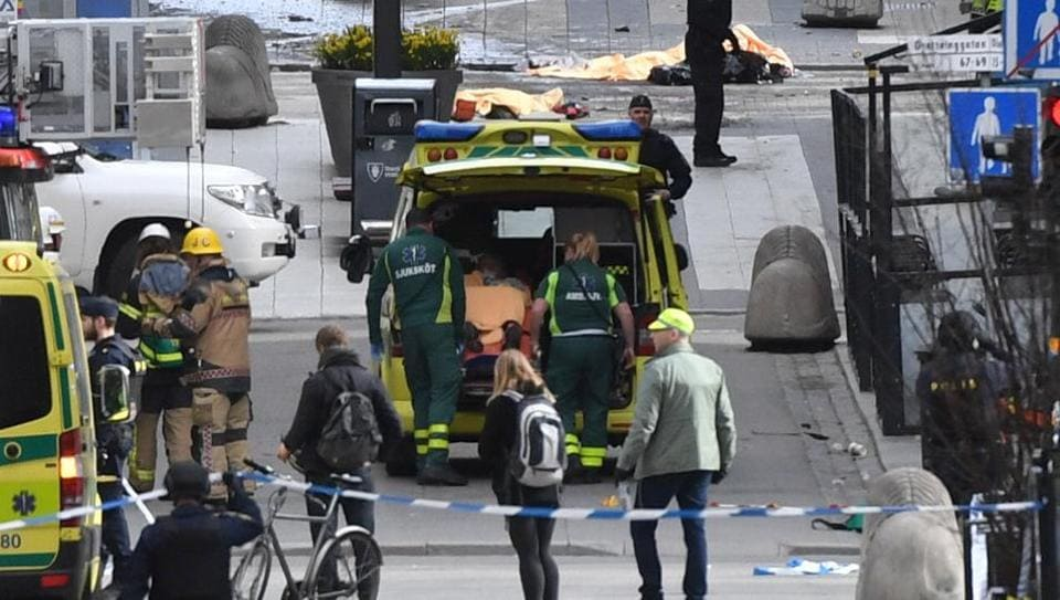 Ambulance in a street near the site were a truck was driven into a crowd in central Stockholm, killing at least three people.