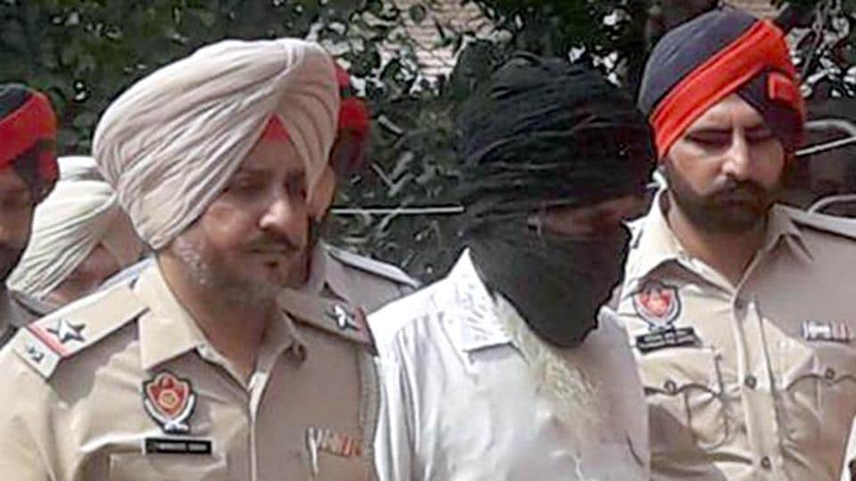 Police taking sacrilege accused Sukhdev Singh to a court in Tarn Taran on Thursday.