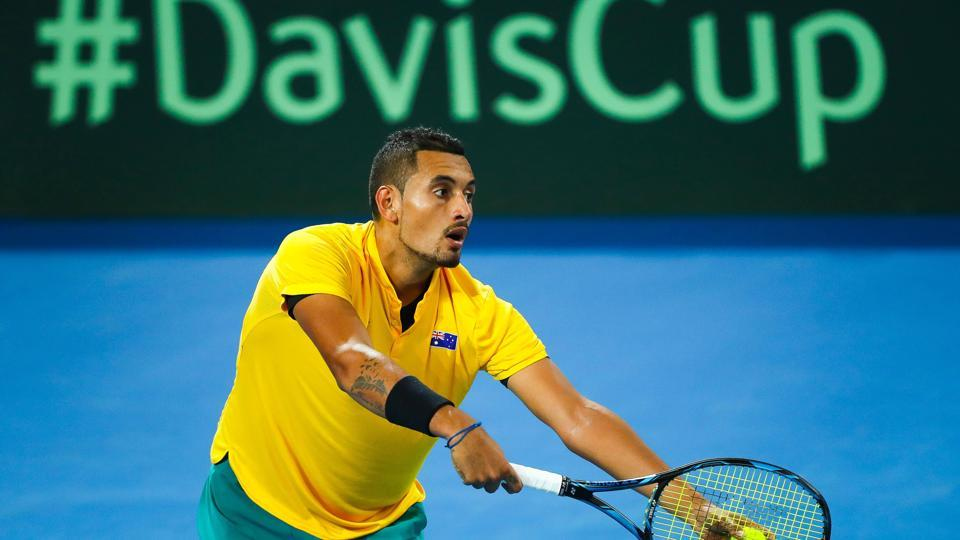 Nick Kyrgios of Australia serves to John Isner of the US during the Davis Cup World Group quarterfinal at the Pat Rafter Arena in Brisbane on Friday.