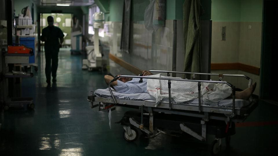 Eizz al-Deen Habash, 39, lies on a bed before his ankle surgery at Shifa hospital, Gaza's largest public medical facility, in Gaza City. But Israel tightly restricts Palestinian passage from the Gaza Strip. (Mohammed Salem/REUTERS)