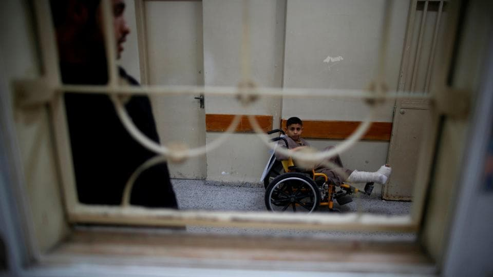 Mohammed Bahtiti, 13, who fractured his leg, waits for medical checks at an outpatient clinic at Shifa hospital. (Mohammed Salem/REUTERS)