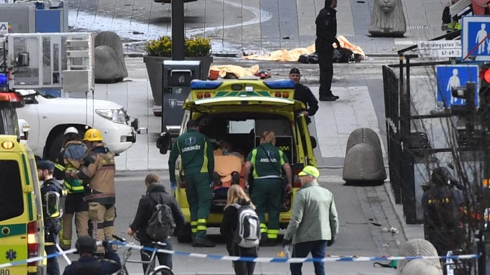 Emergency services work at the scene where a truck crashed into the Ahlens department store at Drottninggatan in central Stockholm.