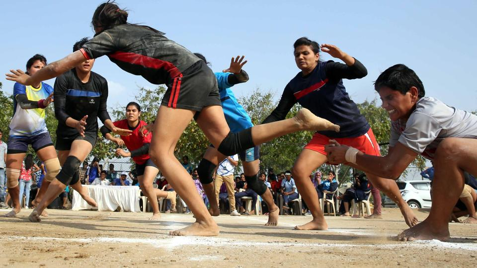 Girls from Jaipur and Bikaner battle it out in a Kabaddi match at rural games in Jaipur. (Himanshu Vyas/ht photo)