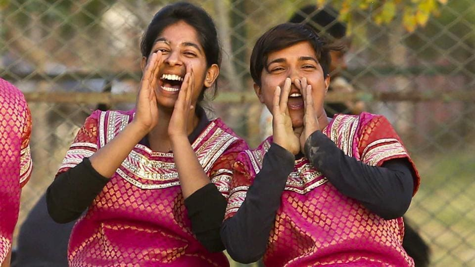 Girls wearing traditional attire from a Jaipur city team rejoice over their win after defeating rivals in the Rumal-Jhapatta game. (Himanshu Vyas/ht photo)
