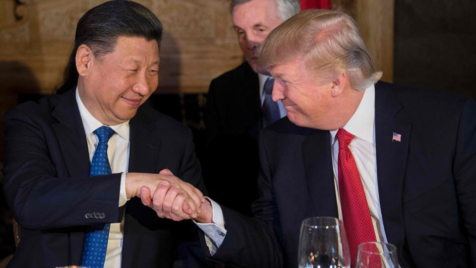 US President Donald Trump and Chinese President Xi Jinping shake hands during dinner at the Mar-a-Lago estate in West Palm Beach, Florida, on April 6.