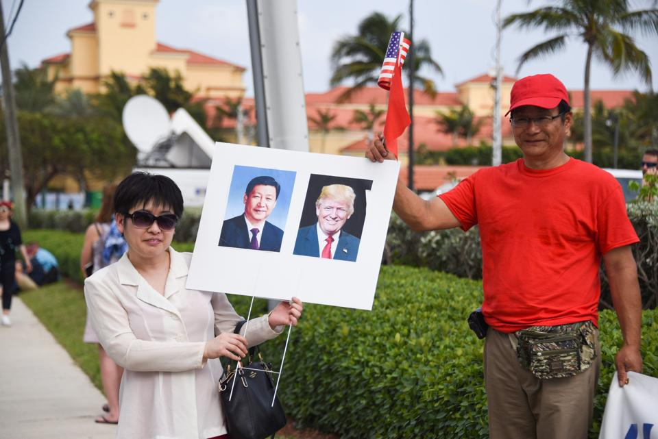 Supporters demonstrate outside the hotel where Chinese President Xi Jinping and his wife Peng Liyuan are staying. Trump promised during the 2016 presidential campaign to stop what he called the theft of American jobs by China and rebuild the country's manufacturing base. (Michele Eve Sandberg/AFP)