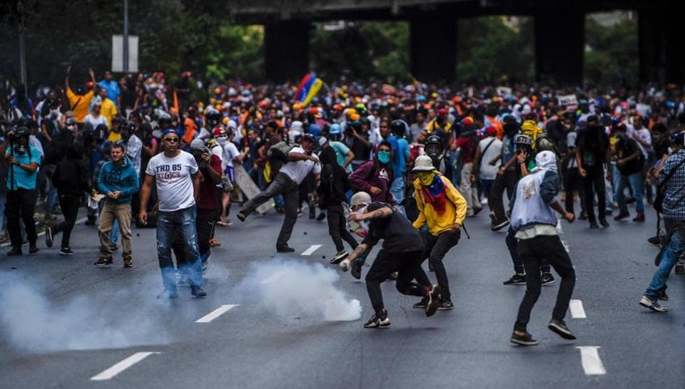 Venezuelan activists clash with police during a protest against the government of President Nicolas Maduro.
