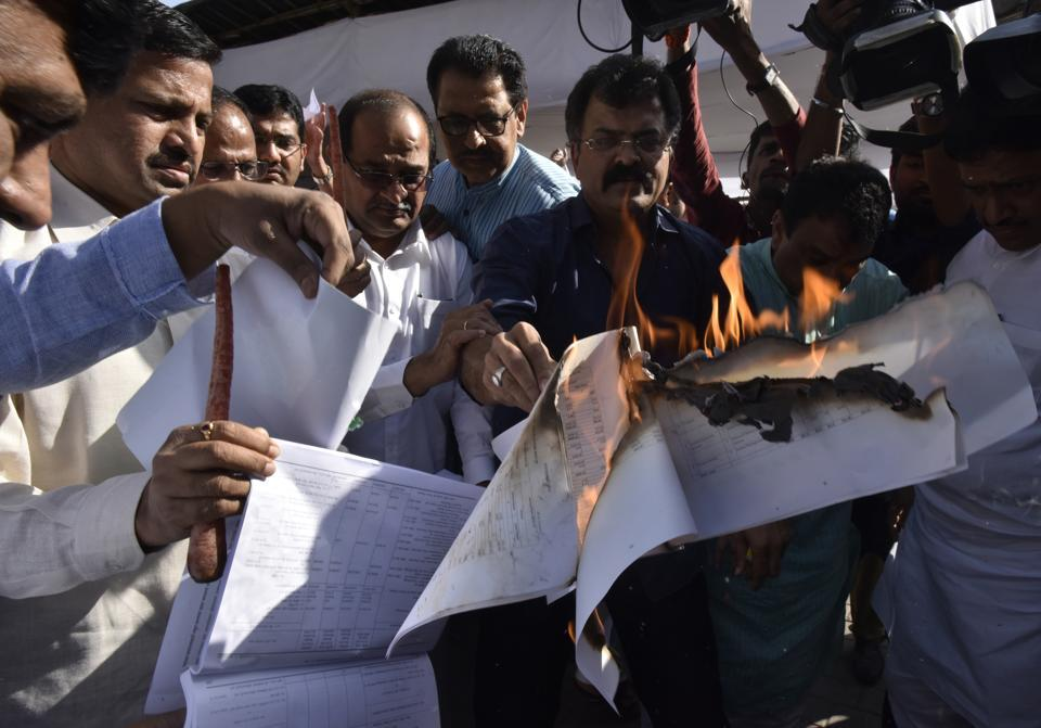 Nineteen opposition legislators were suspended on March 22 for disrupting the proceedings and burning copies of the budget.