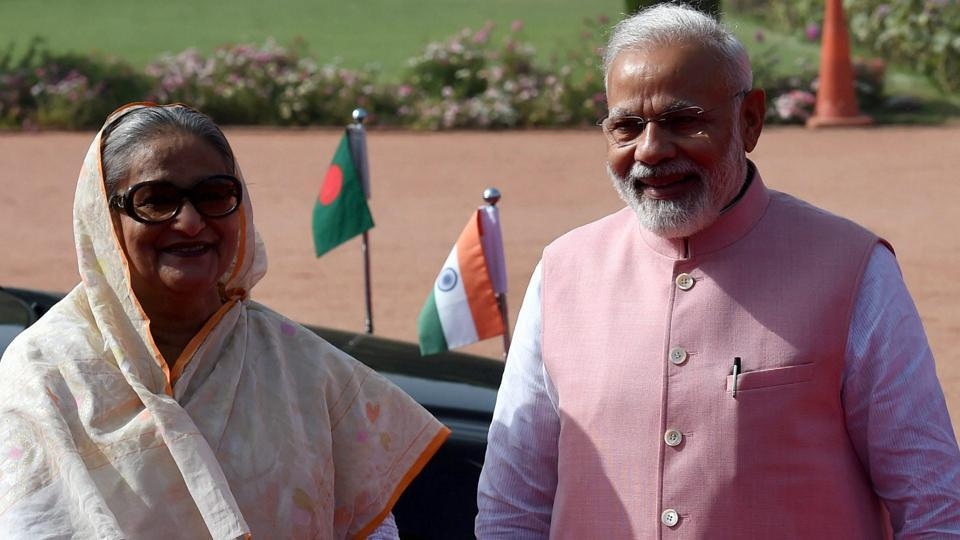 Prime Minister Narendra Modi with his Bangladeshi counterpart Sheikh Hasina (L) during the ceremonial reception at the forecourt of Rashtrapati Bhawan in New Delhi on Saturday.