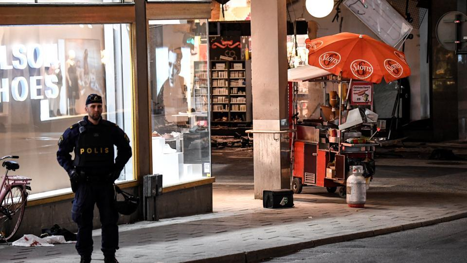 Damage to the department store Ahlens is seen after the beer truck was towed away following a suspected terror attack on the Drottninggatan Street in central Stockholm, Sweden.