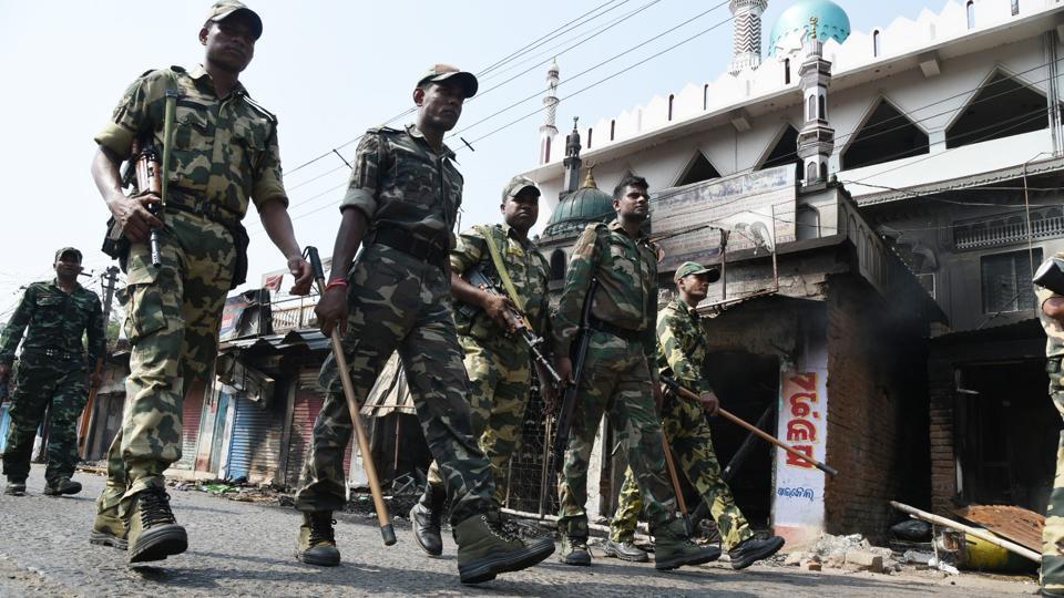 Securitymen on duty as tension simmers in Odisha's Bhadrak after failed peace talks.