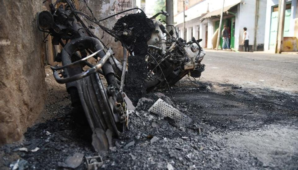 A burnt vehicle lay on a deserted road in the wake of communal violence in coastal Odisha's Bhadrak town. (Arabinda Mahapatra/HTPhoto)
