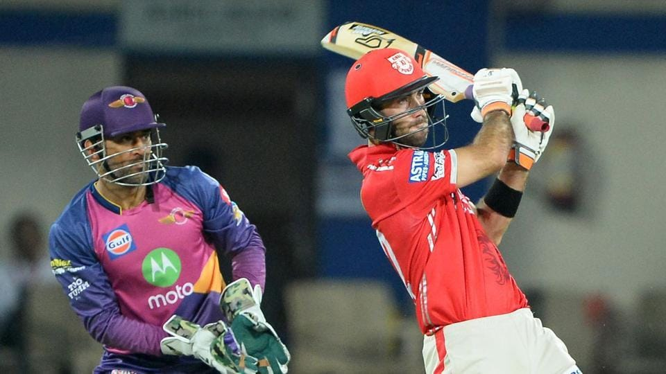 Kings XI Punjab batsman Glenn Maxwell goes for a pull as Rising Pune Supergiants wicketkeeper MS Dhoni looks on during their Indian Premier League match at the Holkar Stadium in Indore on Saturday.