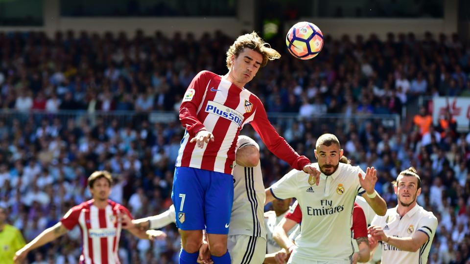 Atletico Madrid's Antoine Griezmann  heads the ball during their La Liga match against Real Madrid at the Santiago Bernabeu in Madrid on Saturday.