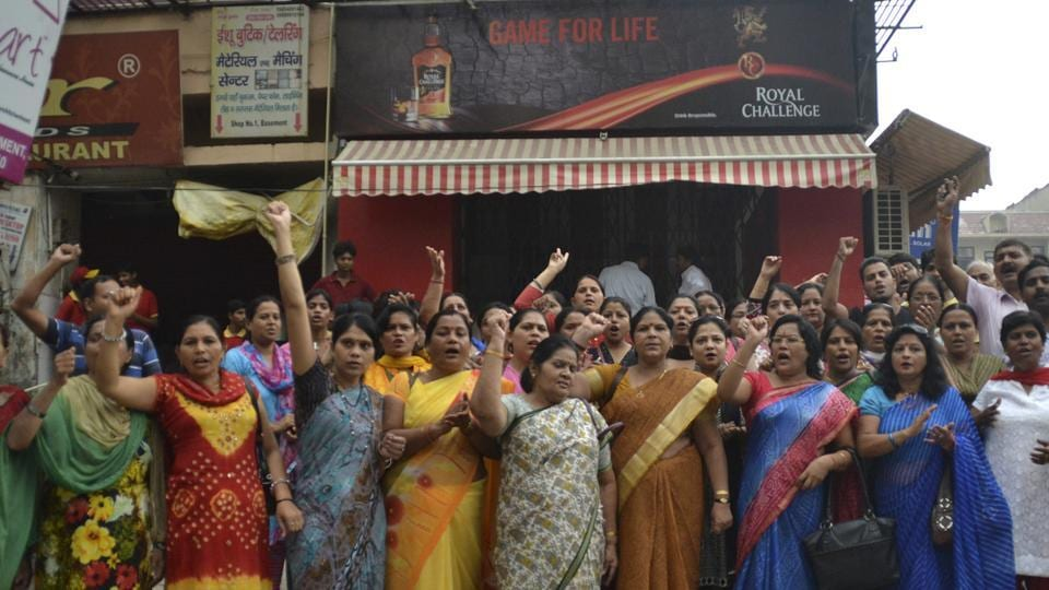 Residents of Vaishali area of Ghaziabad are seen staging a protest against the permission issued to open a liquor shop in their locality a few years ago.