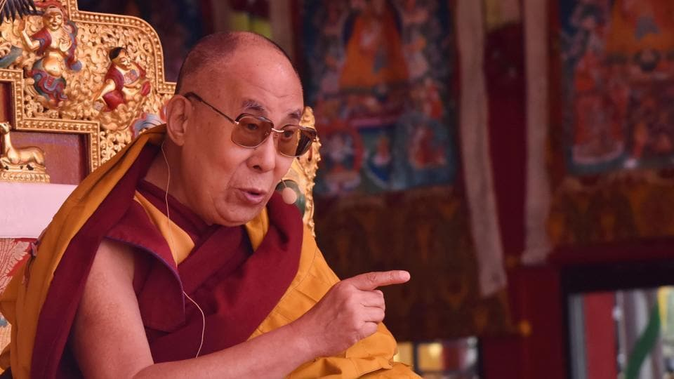 Exiled Tibetan spiritual leader the Dalai Lama delivers teachings to Buddhist followers at the Yiga Choezin ground in Tawang District near the India-China border in Arunachal Pradesh.