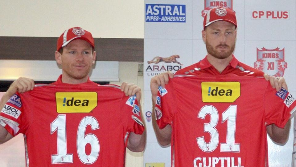 Kings XI Punjab players Eoin Morgan (left) and Martin Guptill display the team jersey in Indore. Live streaming and live cricket score of Saturday's 2017 Indian Premier League match between Kings XI Punjab vs Rising Pune Supergiants will be available online.