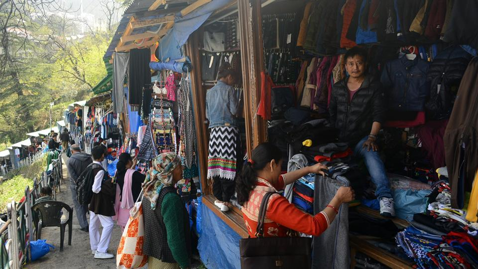 People shopping at the Tibetan market at Lakkar Bazaar in Shimla on Saturday.