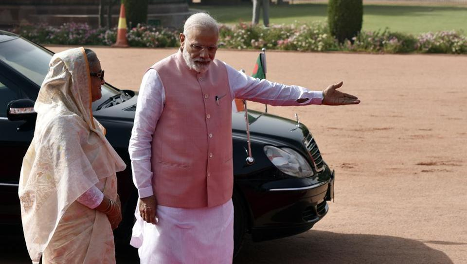 Prime Minister Narendra Modi welcomes his Bangladesh counterpart Sheikh Hasina at Rashtrapati Bhavan in New Delhi on Saturday.