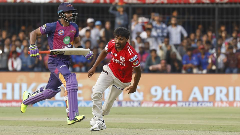 Rising Pune Supergiants' Manoj Tiwary takes a single as Sandeep Sharma of Kings XI Punjab looks at the ball at the Holkar Stadium in Indore on Saturday.  (BCCI)